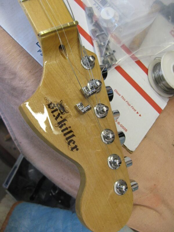 stratocaster head with sixkiller logo