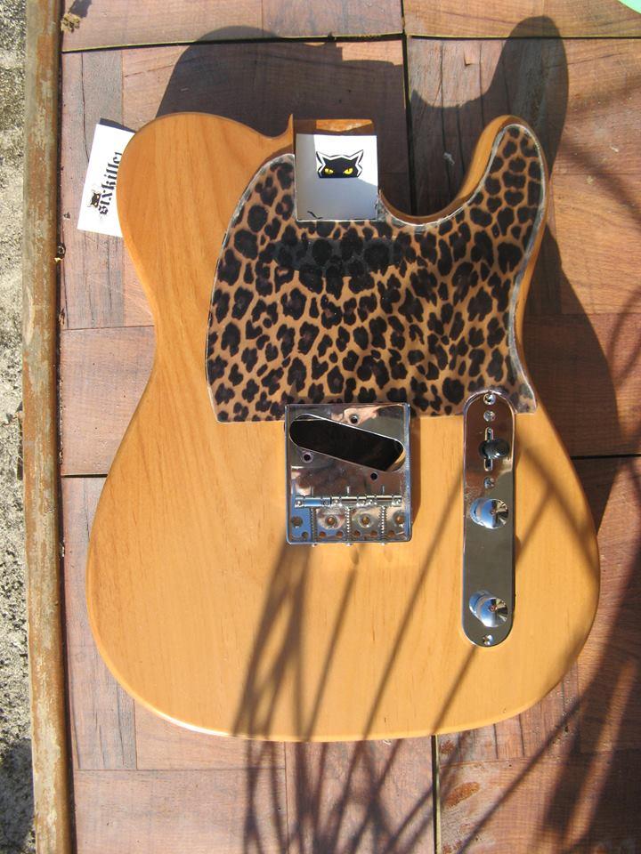 leopard pickguard on a natural guitar