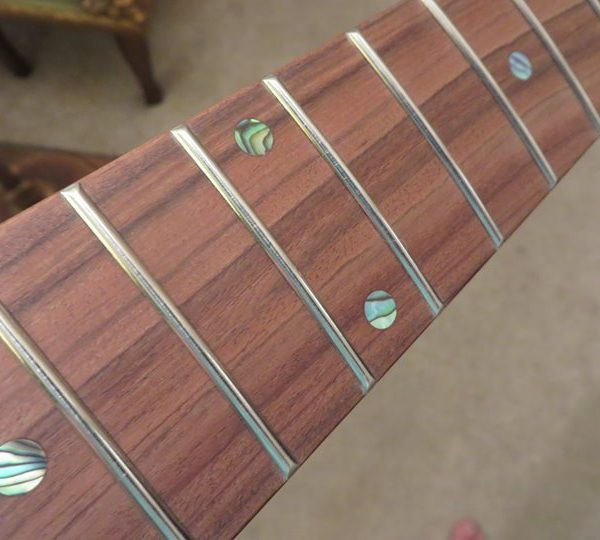 Roasted Curly Maple Stratocaster Neck close-up of frets