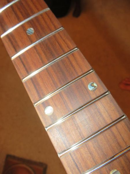 Roasted Curly Maple Telecaster guitar neck frets with abalone dots