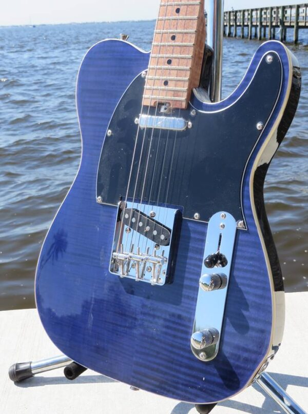 by the water close-up of blue flame maple topped tele